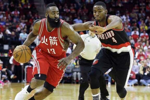 Houston Rockets' James Harden (13) drives the ball past Portland Trail Blazers' Maurice Harkless (4) in the second half of an NBA basketball game Saturday, Feb. 6, 2016, in Houston. Portland won 96-79. (AP Photo/Pat Sullivan)