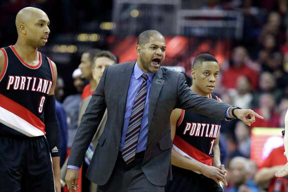 Houston Rockets interim head coach J.B. Bickerstaff, center, yells at a referee as Portland Trail Blazers Gerald Henderson (9) and Tim Frazier (10) head to the bench in the second half of an NBA basketball game Saturday, Feb. 6, 2016, in Houston. Portland won 96-79. (AP Photo/Pat Sullivan)
