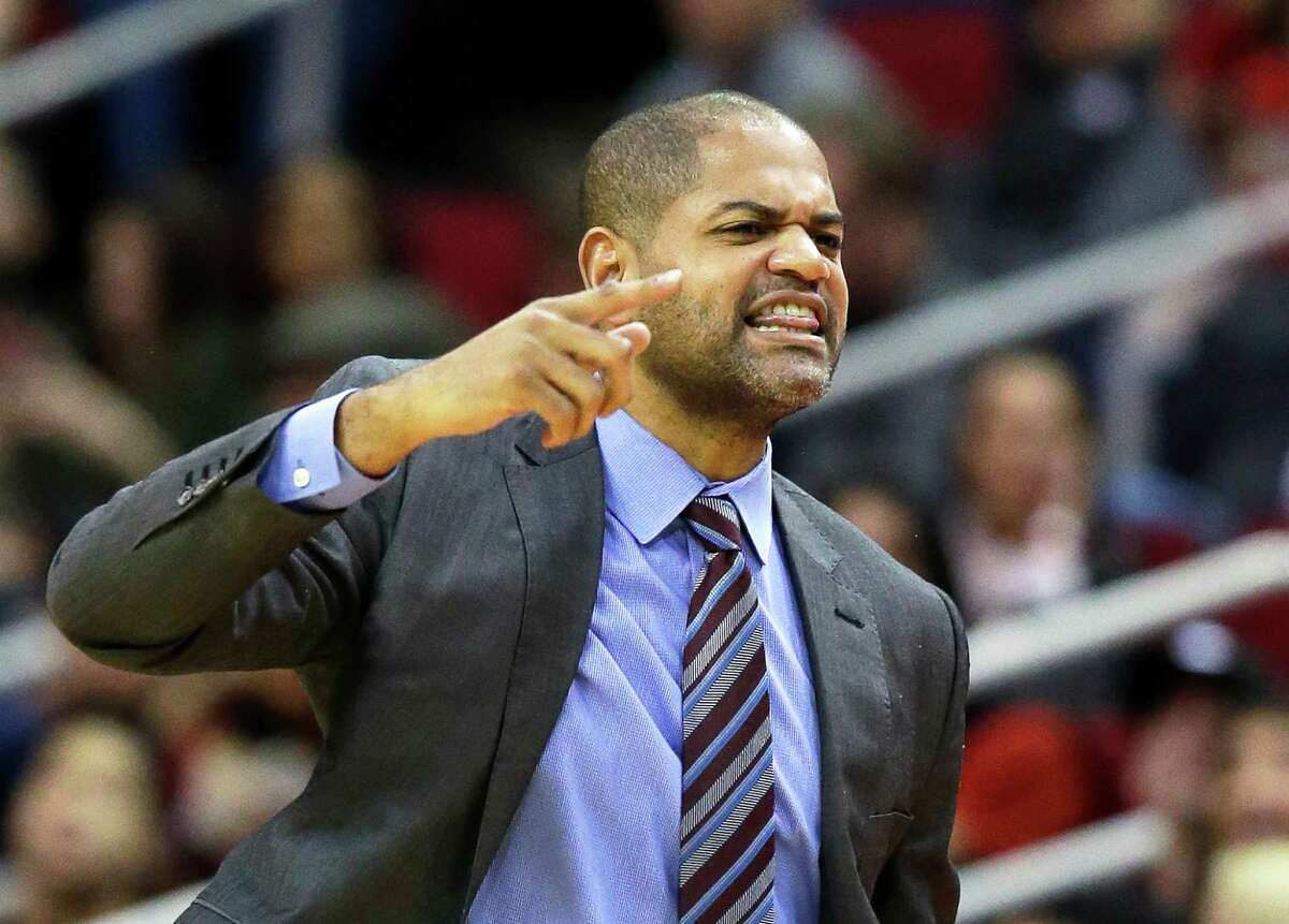 Rockets interim coach J.B. Bickerstaff yells at a referee in the second half of Saturday's game against the Trail Blazers at Toyota Center.