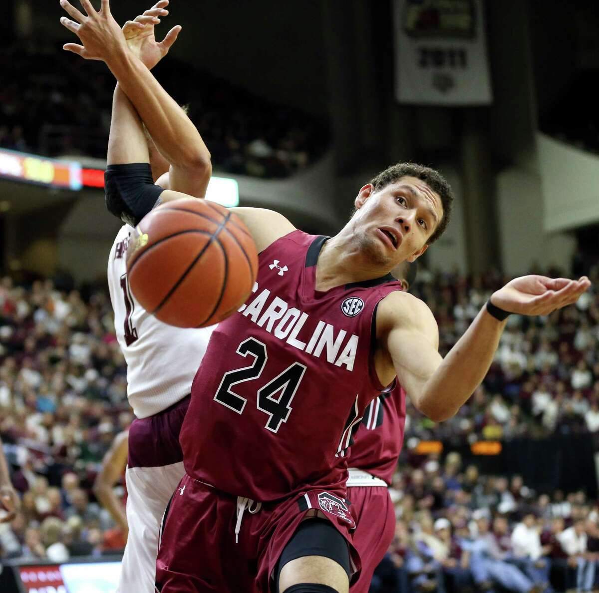 South Carolina's Michael Carrera (24) gets tangled up with Texas A&M's D.J. Hogg (1) while going after a rebound during the first half of an NCAA college basketball game, Saturday, Feb. 6, 2016, in College Station, Texas. South Carolina won 81-78. (AP Photo/Sam Craft)