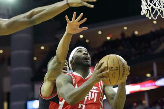Guard Ty Lawson and the Rockets faced an uphill climb for most of the night against the Trail Blazers.