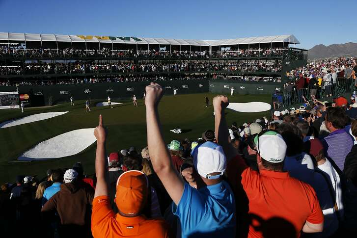 SCOTTSDALE, AZ - FEBRUARY 05:  Fans react as Rickie Fowler putts on the 16th green during the second round of the Waste Management Phoenix Open at TPC Scottsdale on February 5, 2016 in Scottsdale, Arizona.  (Photo by Christian Petersen/Getty Images)
