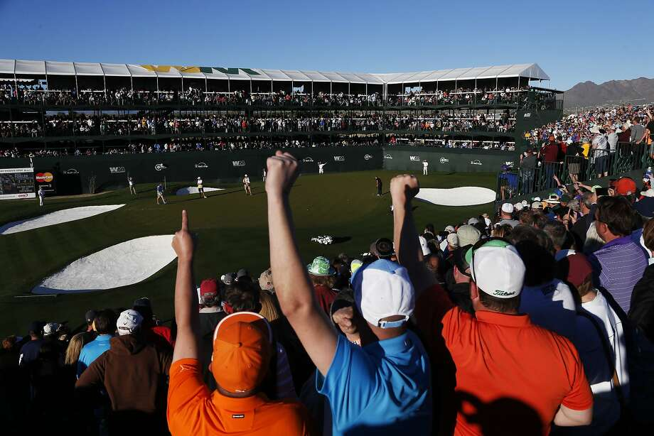 Thousands react to Rickie Fowler's putt on the 16th green at the Waste Management Phoenix Open. Photo: Christian Petersen, Getty Images