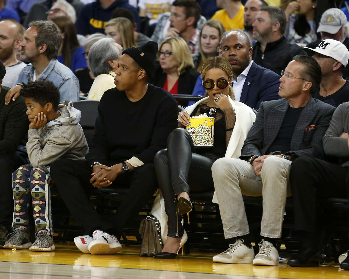 Jay Z and Beyonce watch during the second quarter of the basketball game between the Golden State Warriors and the Oklahoma City Thunder on Saturday, February 6, 2016 in Oakland, Calif.