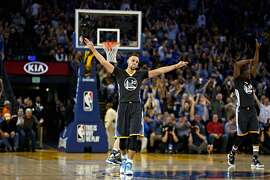 Golden State Warriors guard Stephen Curry celebrates after guard Shaun Livingston made a three pointer while being fouled by Oklahoma City Thunder forward Serge Ibaka during the second quarter of their basketball game on Saturday, February 6, 2016 in Oakland, Calif.