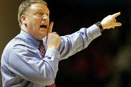 Rice University head basketball coach Mike Rhoades calls  out as Rice's plays the University of St. Thomas during the first half of men's college basketball game at Tudor Fieldhouse Thursday, Dec. 17, 2015, in Houston.