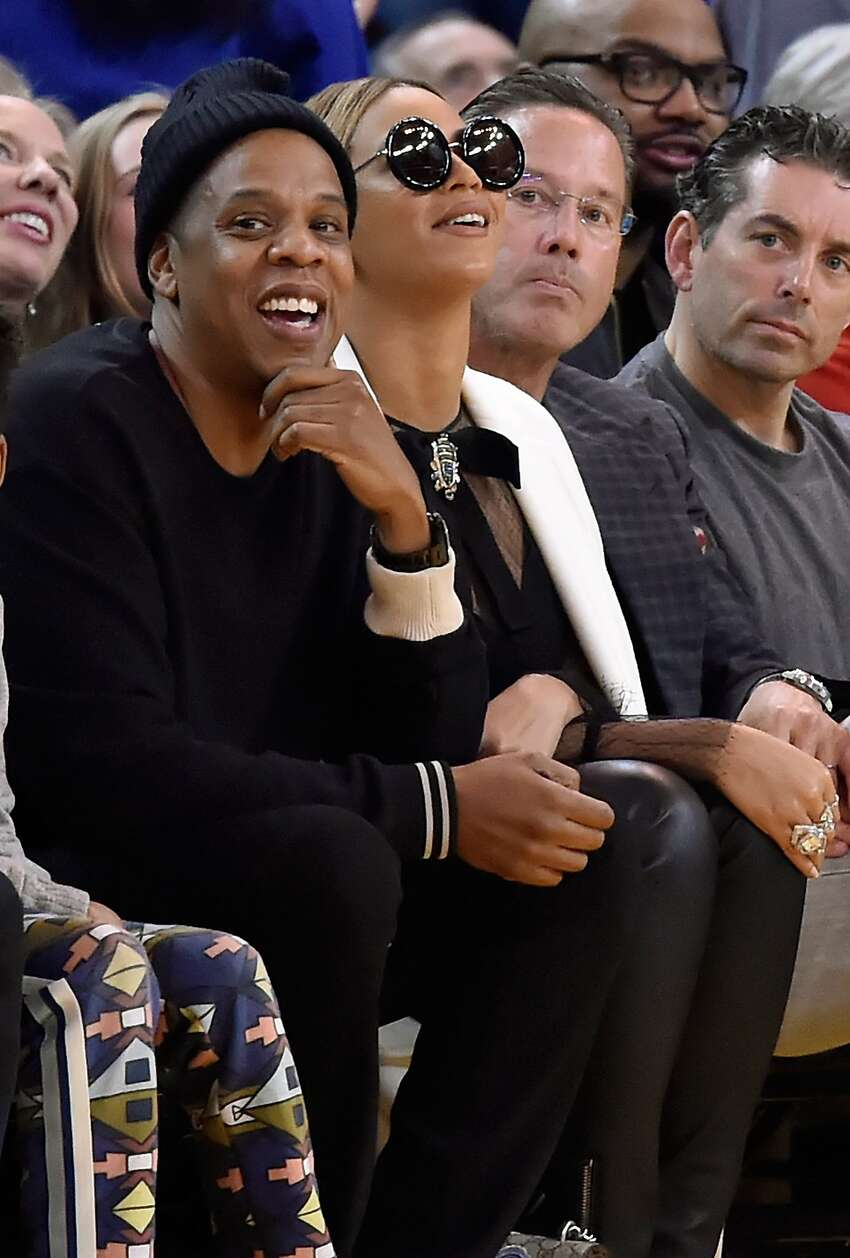 Rapper Jay-Z and wife Beyoncé sits courtside during an NBA basketball game between the Oklahoma City Thunder and Golden State Warriors at ORACLE Arena on February 6, 2016 in Oakland, California.