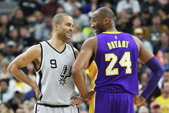 Tony Parker enjoys a light hearted moment with Kobe Bryant during the second quarter as the Spurs host the Lakers at the AT&T Center on February 6, 2016.