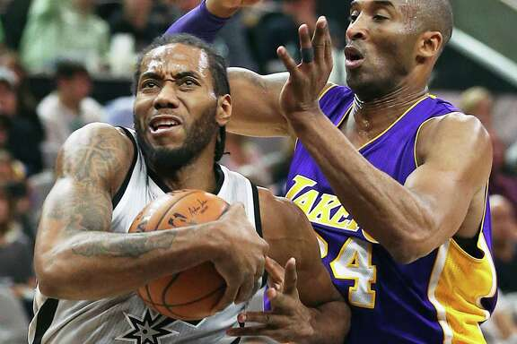 Kawhi Leonard wrestles away from Kobe Bryant as the Spurs host the Lakers at the AT&T Center on Feb. 6, 2016.