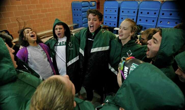 Reagan swimming team goes thru pre-meet cheer. Region VII-6A swimming championship at Josh Davis Natatorium on February 6, 2016