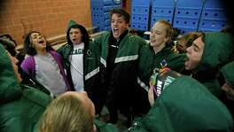 Reagan swimming team goes thru pre-meet cheer. Region VII-6A swimming championship at Josh Davis Natatorium on February 6, 2016