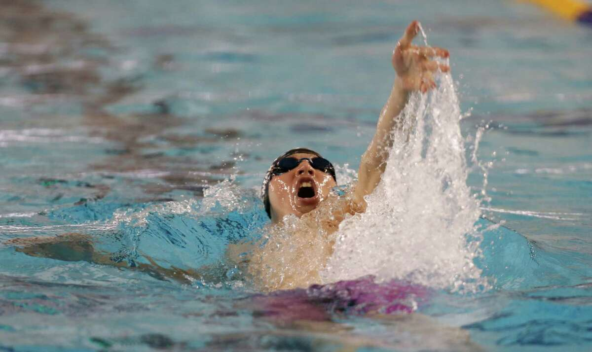 Reagan's Nicholas A Joswiak wins the boys 200 Yard IM. Region VII-6A swimming championship at Josh Davis Natatorium on February 6, 2016