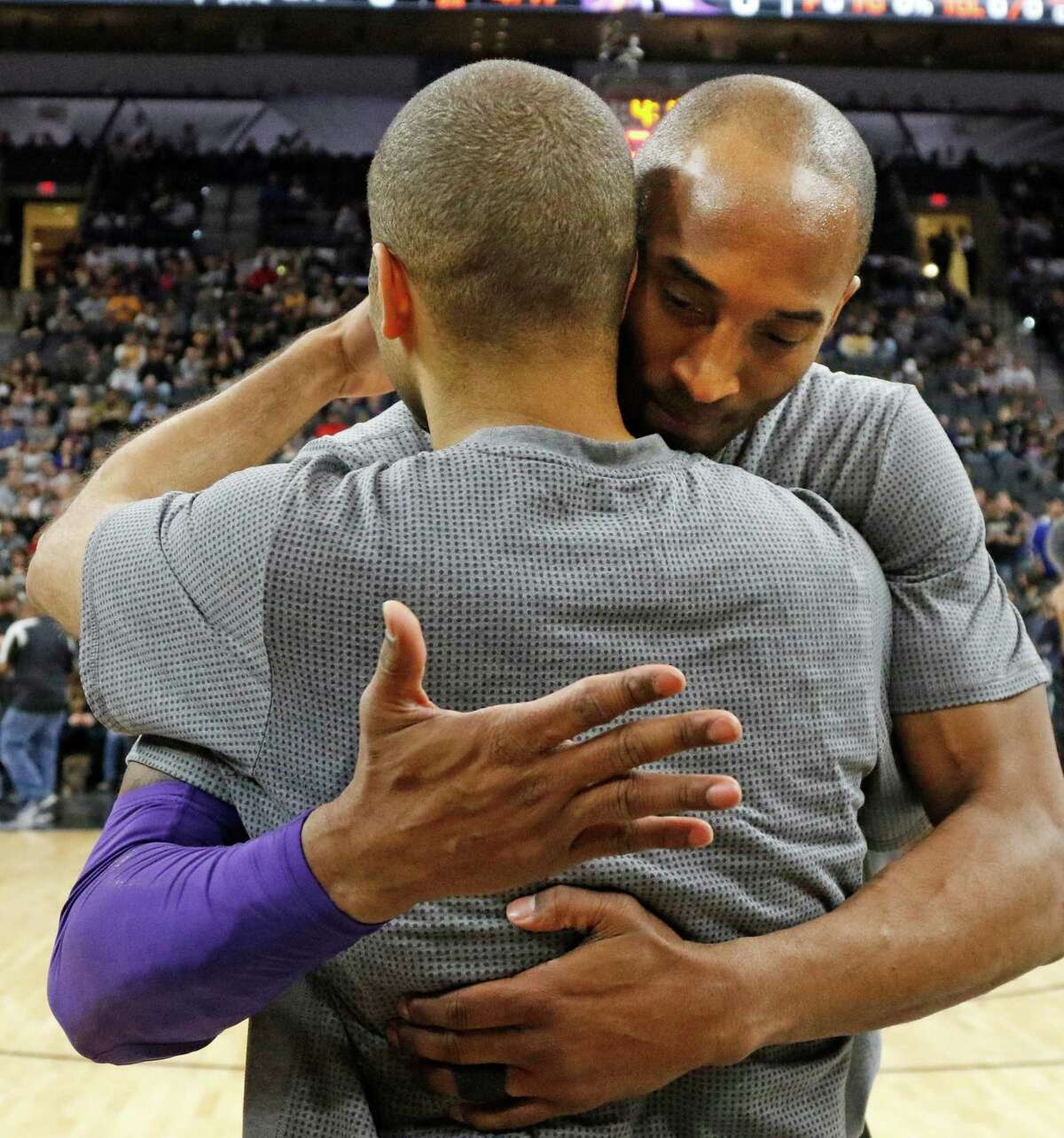 SAN ANTONIO,TX - FEBRUARY 6: Tony Parker #9 of the San Antonio Spurs gets a hug from Kobe Bryant #24 of the Los Angeles Lakers at AT&T Center on February 6, 2016 in San Antonio, Texas. NOTE TO USER: User expressly acknowledges and agrees that , by downloading and or using this photograph, User is consenting to the terms and conditions of the Getty Images License Agreement.