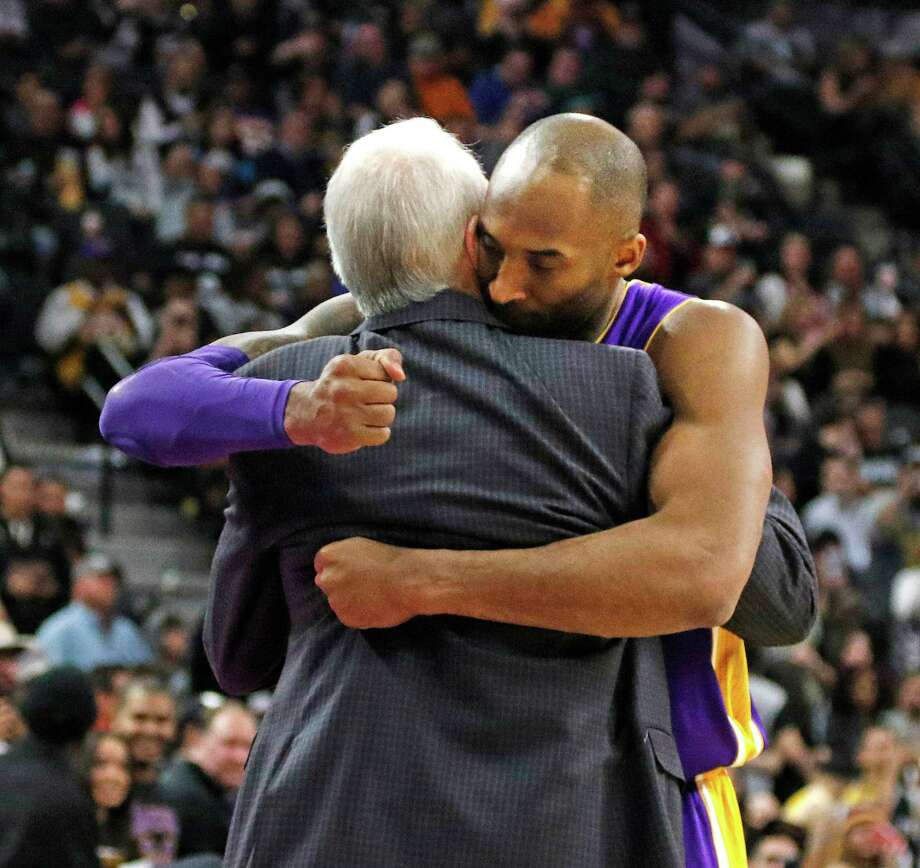 SAN ANTONIO,TX - FEBRUARY 6: Kobe Bryant #24 of the Los Angeles Lakers hugs San Antonio head coach Gregg Popovic at AT&T Center on February 6, 2016 in San Antonio, Texas.  NOTE TO USER: User expressly acknowledges and agrees that , by downloading and or using this photograph, User is consenting to the terms and conditions of the Getty Images License Agreement. Photo: Ronald Cortes, Getty Images / 2016 Getty Images