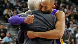 SAN ANTONIO,TX - FEBRUARY 6: Kobe Bryant #24 of the Los Angeles Lakers hugs San Antonio head coach Gregg Popovic at AT&T Center on February 6, 2016 in San Antonio, Texas.  NOTE TO USER: User expressly acknowledges and agrees that , by downloading and or using this photograph, User is consenting to the terms and conditions of the Getty Images License Agreement.