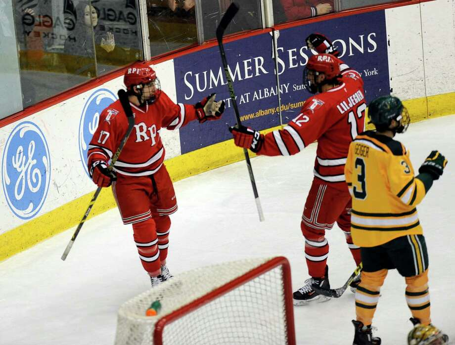 Rensselaer Polytechnic Institute's Milos Bubela (17) celebrates his goal with teammate Viktor Liljegren (12) against Clarkson in the first period of an NCAA college hockey game Friday, Feb. 6, 2016, in Troy, N.Y., (Hans Pennink / Special to the Times Union) ORG XMIT: HP101 Photo: Hans Pennink / 10035277A