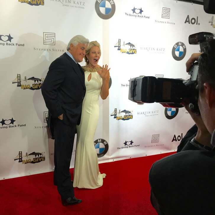 Auction emcee Jay Leno with host Jillian Manus at her Big Game, Big Give party Feb. 6 in Atherton.