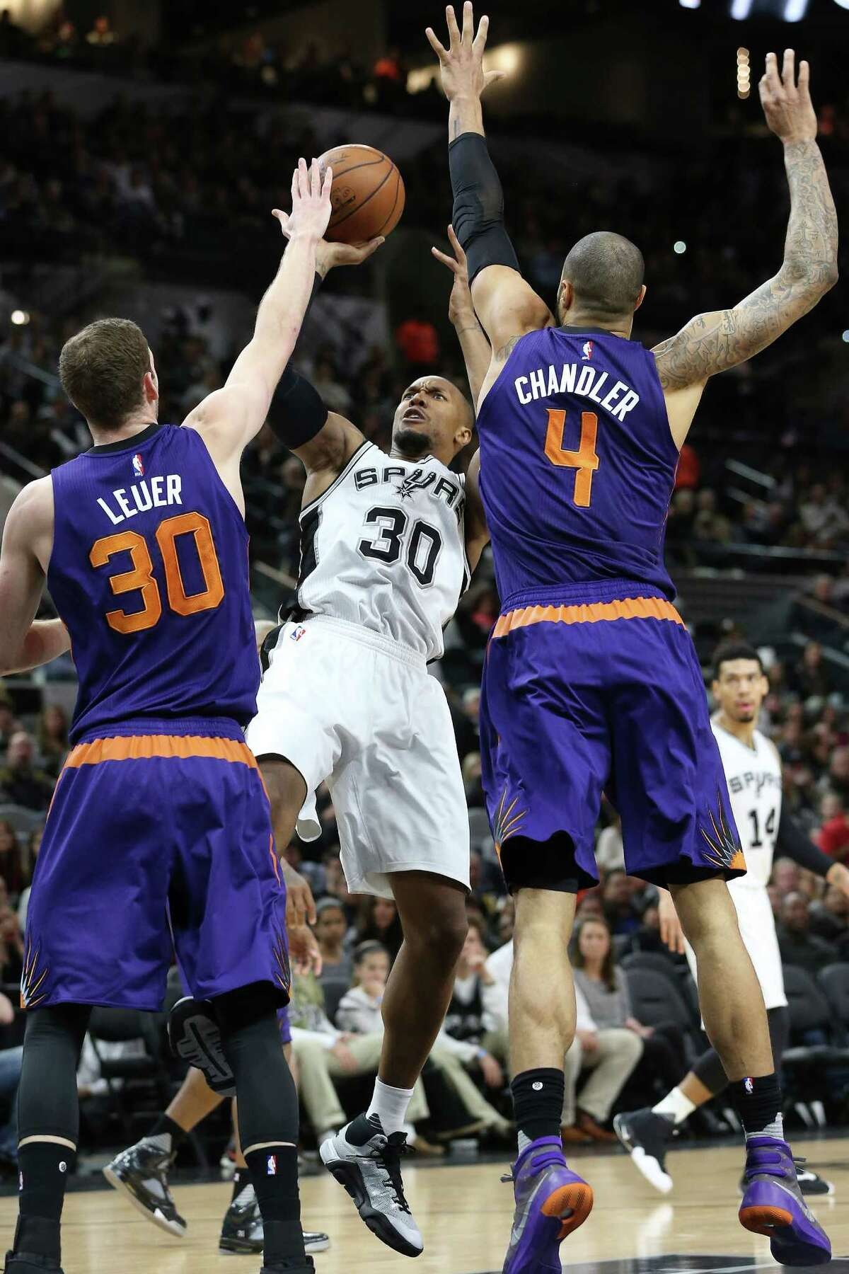 David West fades back for a shot against Jon Leuer and Tyson Chandler as the Spurs host the Suns at the AT&T Center on Dec. 30, 2015.