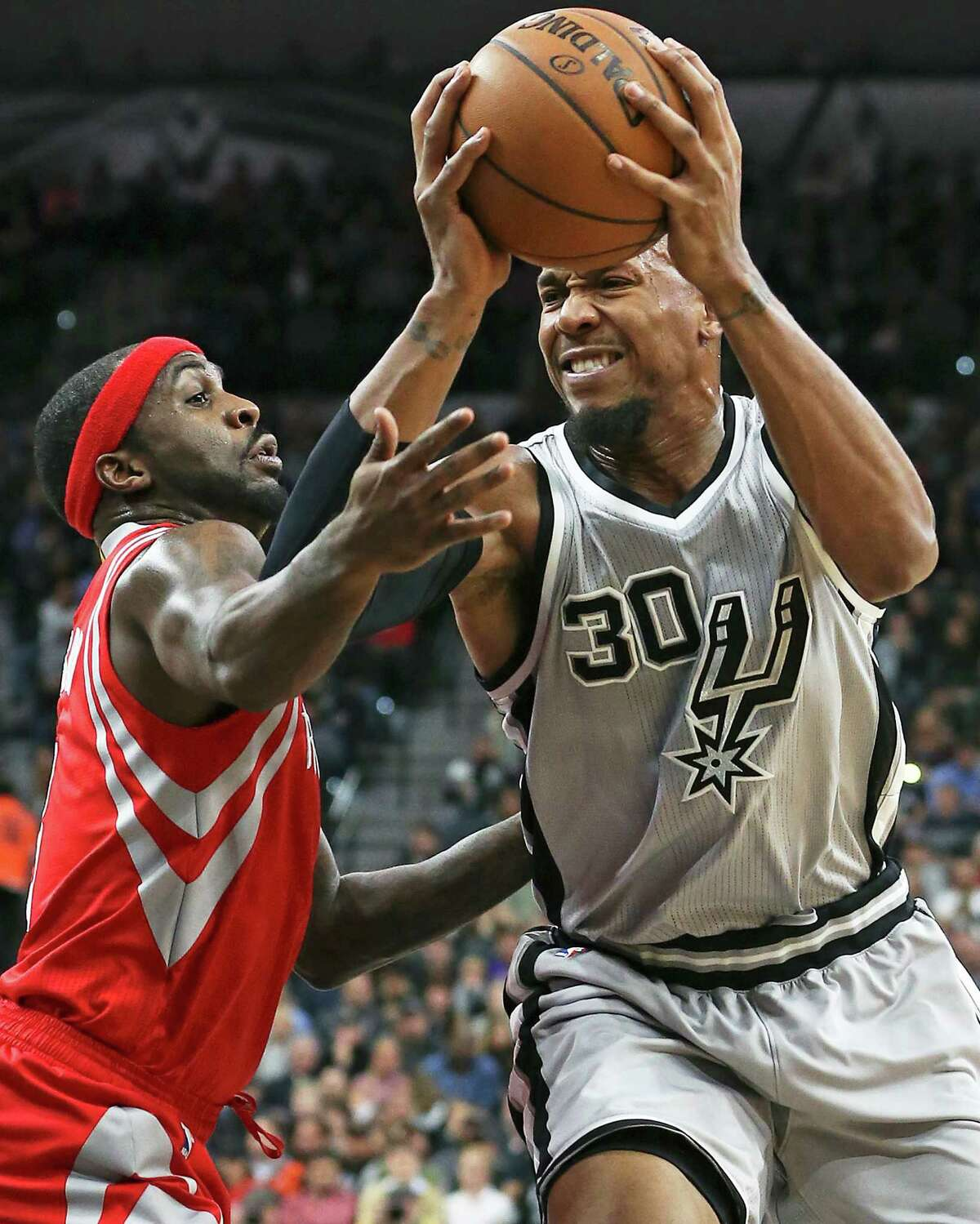 David West starts on his way up against Jason Terry as the Spurs host the Rockets at the AT&T Center on Jan. 2, 2016.
