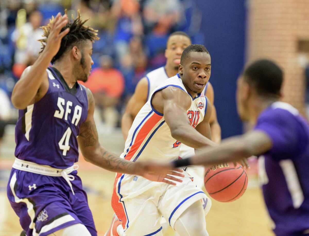Anthony Odunsi (2) of Houston Baptist University drives to the basket in the second half against the Stephen F. Austin Lumberjacks in a college basketball game on Saturday, February 6, 2016 at Sharp Gym.