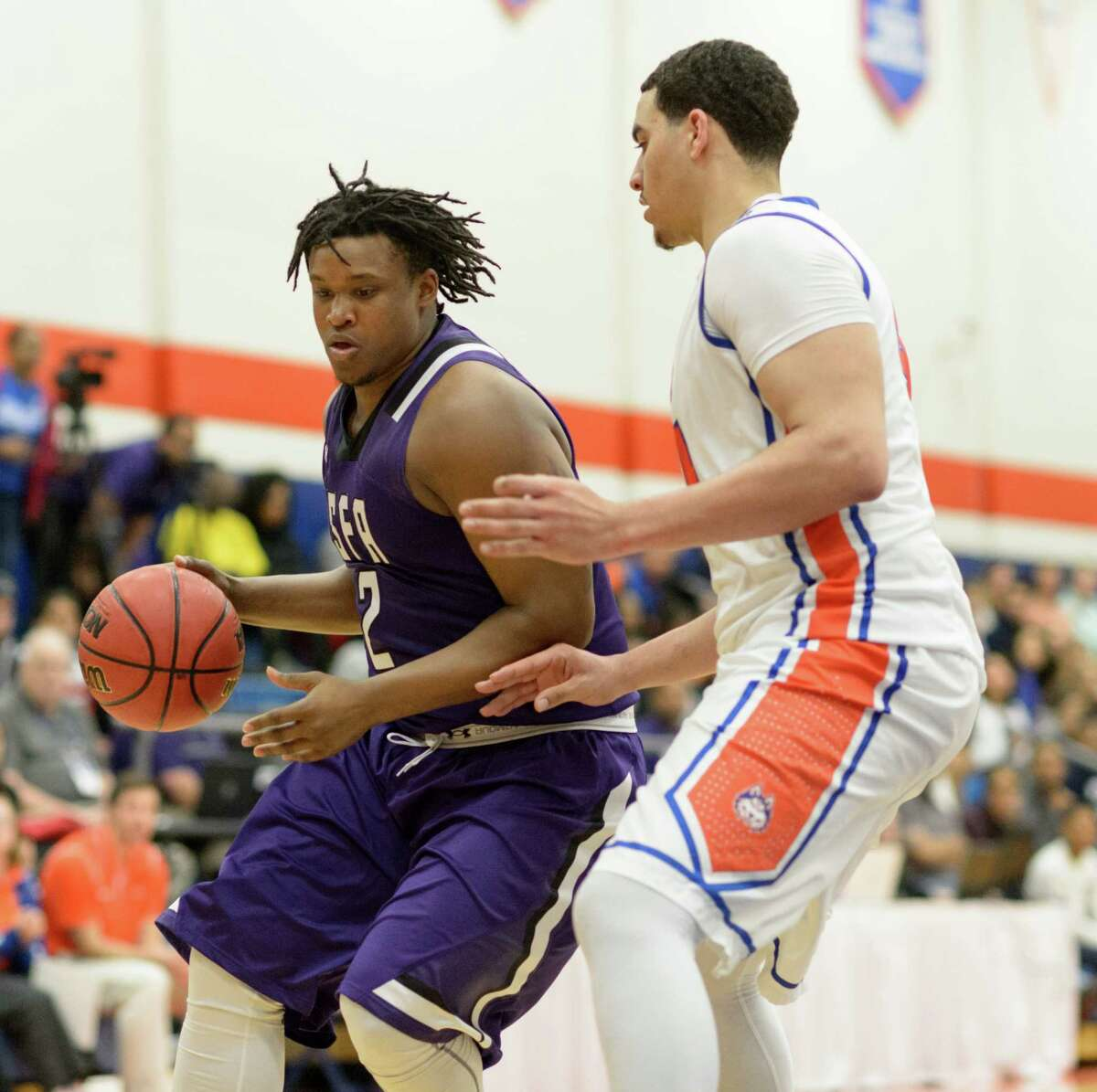 CJ Williams (2) of the Stephen F. Austin Lumberjacks drives to the basket in the second half against Houston Baptist University in a college basketball game on Saturday, February 6, 2016 at Sharp Gym.