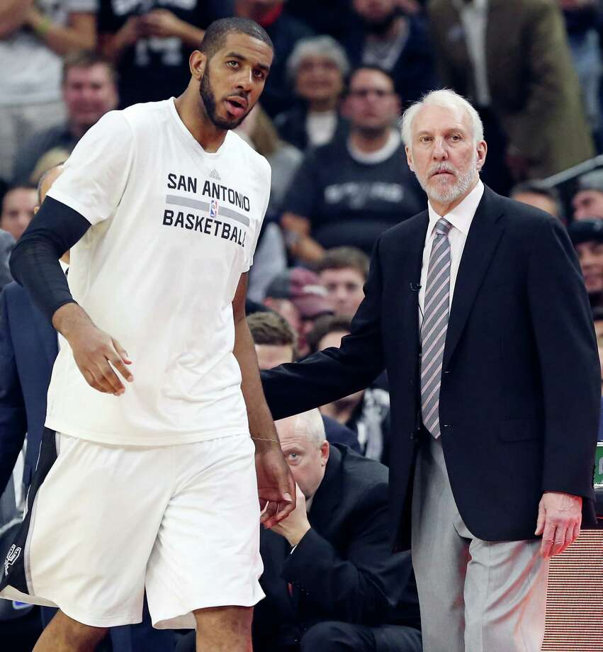 San Antonio Spurs' LaMarcus Aldridge talks with head coach Gregg Popovich during second half action against the Cleveland Cavaliers Thursday Jan. 14, 2016 at the AT&T Center. The Spurs won 99-95. Photo: Edward A. Ornelas, Staff / San Antonio Express-News / © 2016 San Antonio Express-News