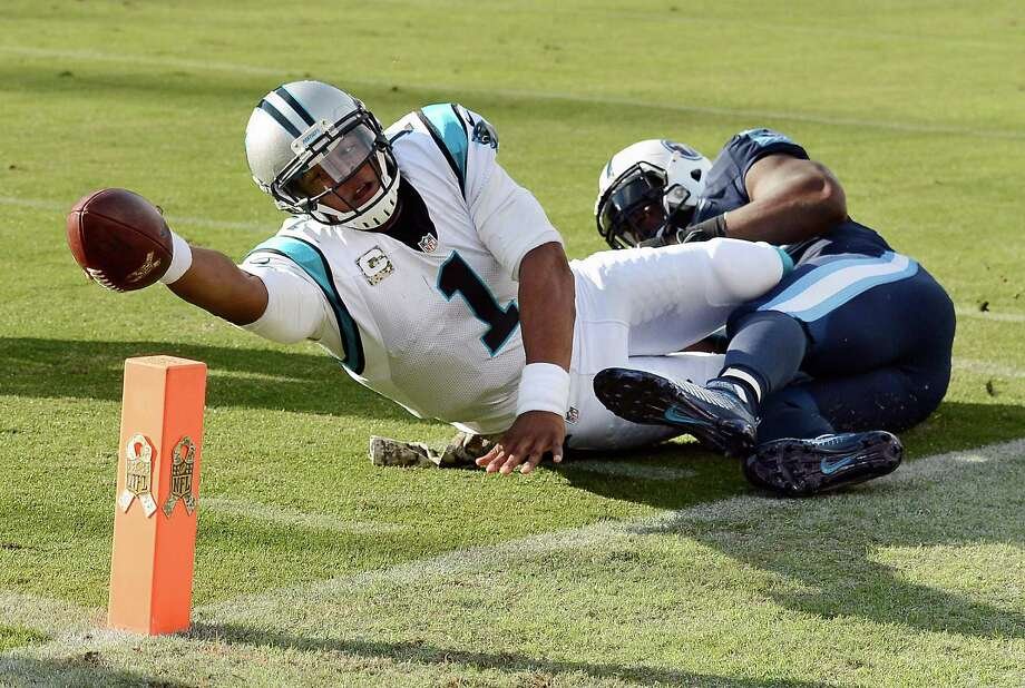 FILE - In this Nov. 15, 2015, file photo, Carolina Panthers quarterback Cam Newton (1) is tackled short of the goal line by Tennessee Titans linebacker Brian Orakpo during an NFL football game in Nashville, Tenn. Newton has won The Associated Press NFL Most Valuable Player award in a landslide. (AP Photo/Mark Zaleski, File) ORG XMIT: NY179 Photo: Mark Zaleski / FR170793 AP