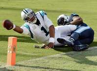 FILE - In this Nov. 15, 2015, file photo, Carolina Panthers quarterback Cam Newton (1) is tackled short of the goal line by Tennessee Titans linebacker Brian Orakpo during an NFL football game in Nashville, Tenn. Newton has won The Associated Press NFL Most Valuable Player award in a landslide. (AP Photo/Mark Zaleski, File) ORG XMIT: NY179