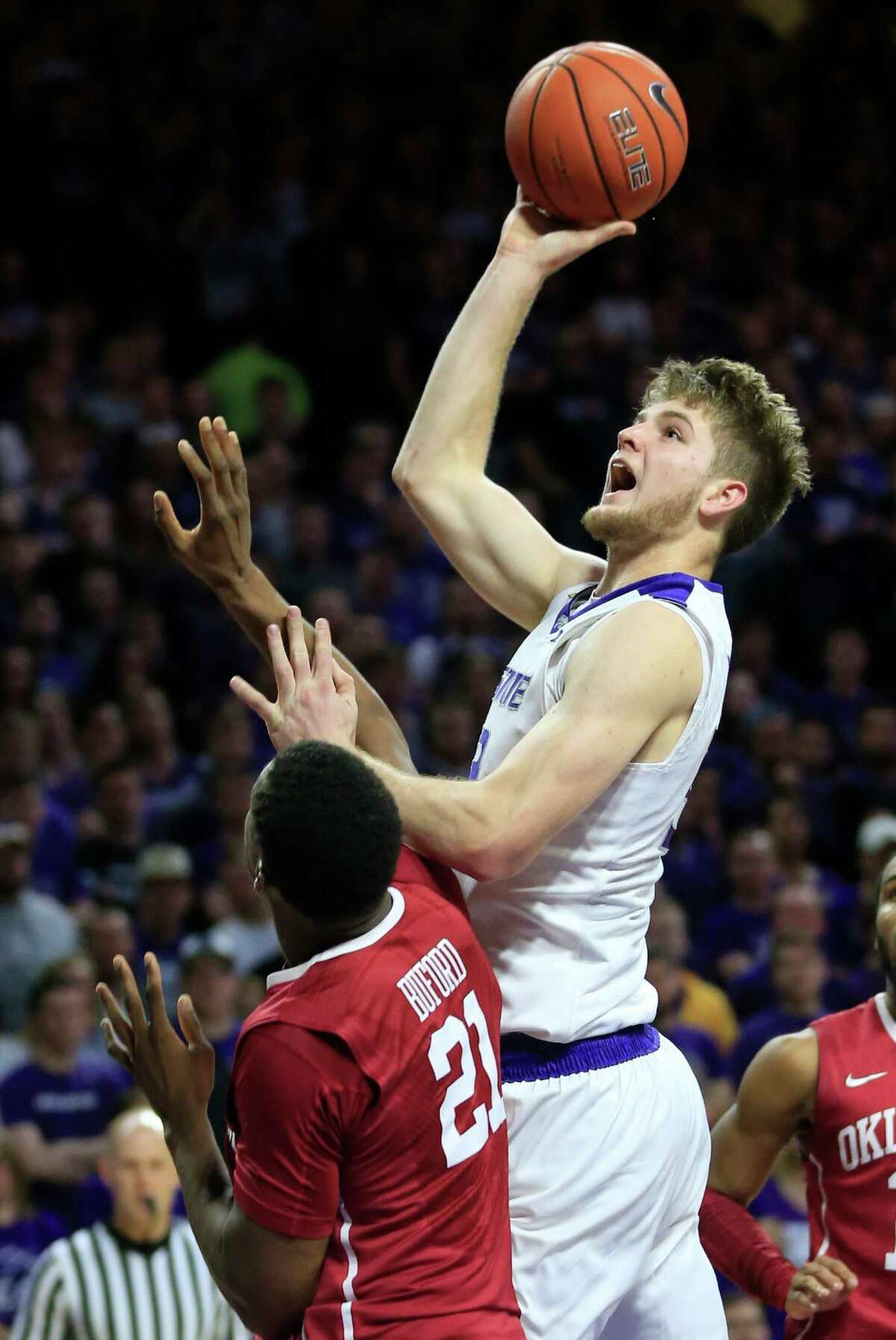 Kansas State forward Dean Wade (32) shoots over Oklahoma forward Dante Buford (21) during the second half of an NCAA college basketball game at Bramlage Coliseum in Manhattan, Kan., Saturday, Feb. 6, 2016. Kansas State defeated Oklahoma 80-69. (AP Photo/Orlin Wagner) ORG XMIT: KSOW113
