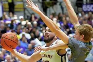 UAlbany basketball comes back to beat Vermont in Big Purple Growl - Photo