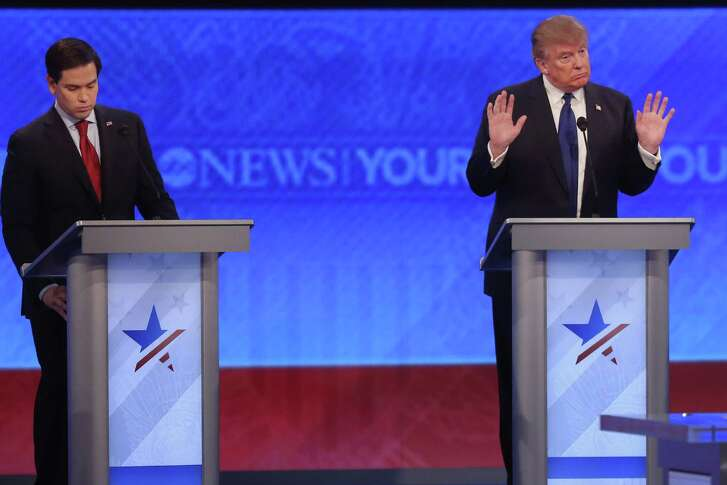 Donald Trump, right, accused Ted Cruz of cheating in Iowa as he returned to the debate stage Saturday at St. Anselm College in Manchester, N.H. Marco Rubio, left, also faced sharp attacks from his GOP rivals.