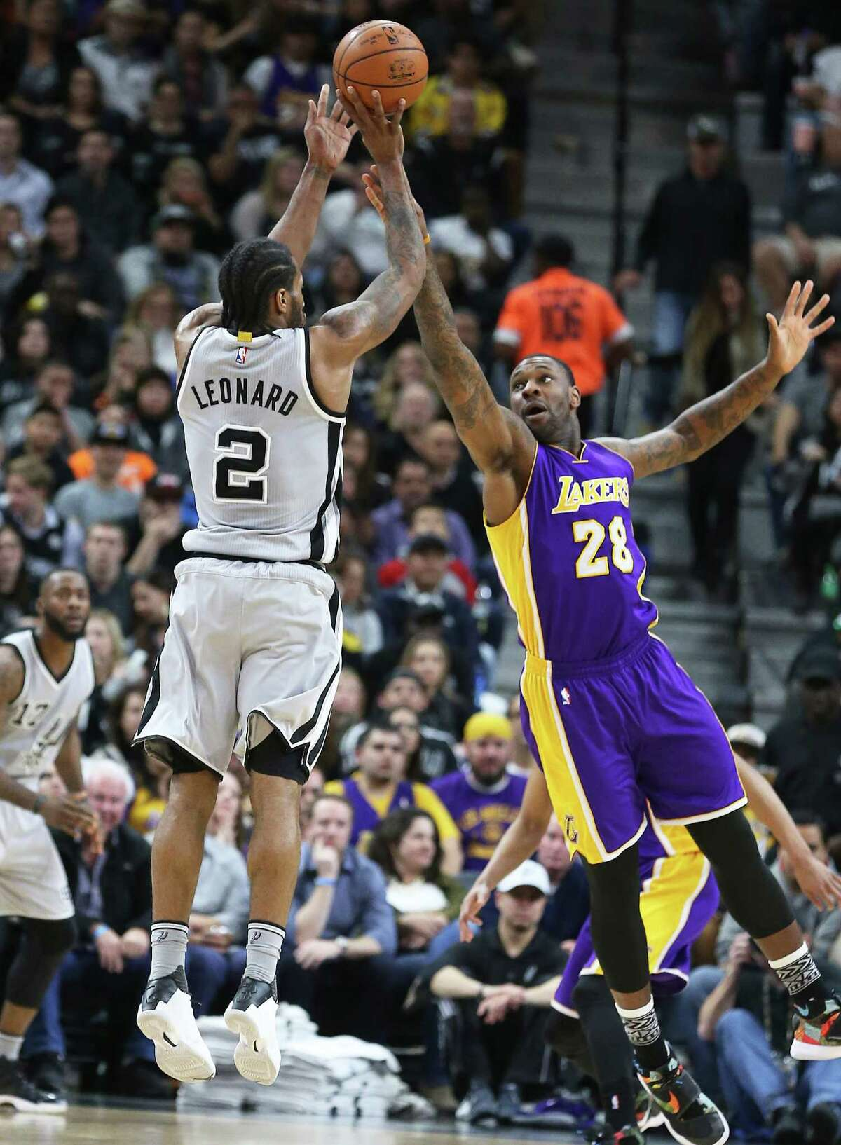 Kawhi Leonard puts a shot up over Tarik Black as the Spurs host the Lakers at the AT&T Center on February 6, 2016.