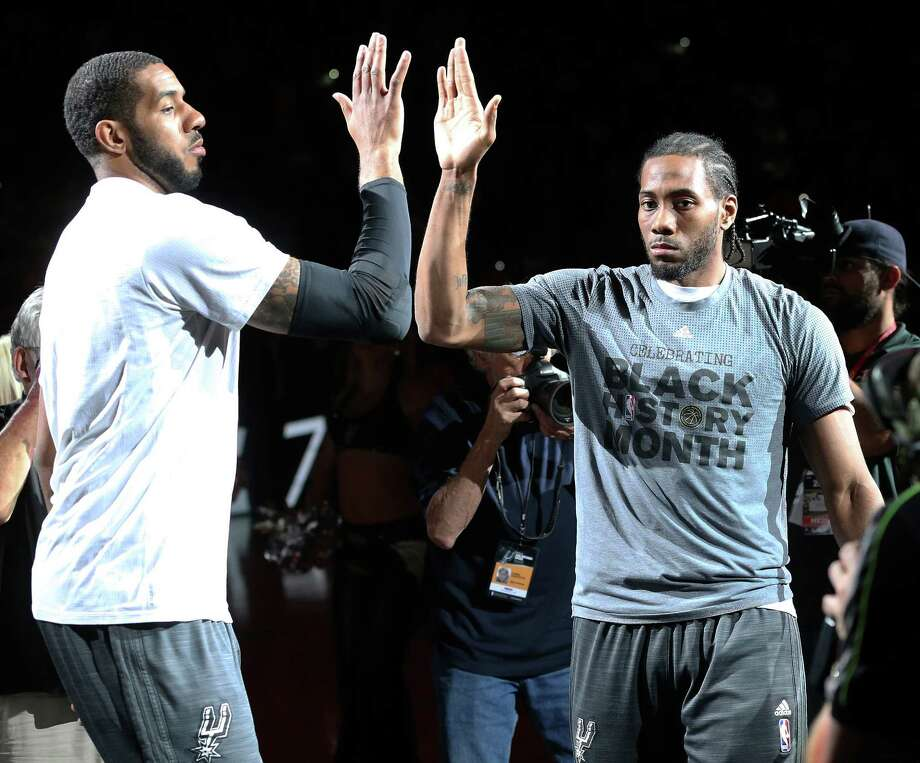 LaMarcus Aldridge and Kawhi Leonard high five in the introductions as the Spurs host the Lakers at the AT&T Center on February 6, 2016. Photo: TOM REEL, STAFF / SAN ANTONIO EXPRESS-NEWS / 2016 SAN ANTONIO EXPRESS-NEWS