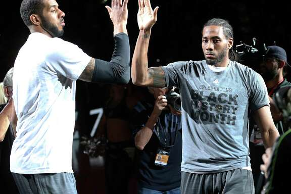 LaMarcus Aldridge and Kawhi Leonard high five in the introductions as the Spurs host the Lakers at the AT&T Center on Feb. 6, 2016.