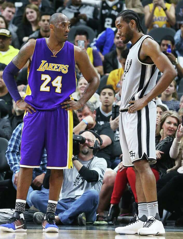 Kobe Bryant looks over at Kawhi Leonard coming out of a timeout as the Spurs host the Lakers at the AT&T Center on Feb. 6, 2016. Photo: Tom Reel /San Antonio Express-News / 2016 SAN ANTONIO EXPRESS-NEWS