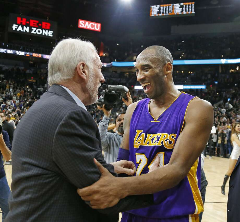 Gregg Popovich greets Kobe Bryant at his last game in San Antonio. Photo: Ronald Cortes, Getty Images