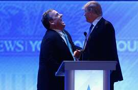 MANCHESTER, NH - FEBRUARY 06:  Republican presidential candidates New Jersey Governor Chris Christie (L) and Donald Trump share a laugh during a commercial break in the Republican presidential debate at St. Anselm College February 6, 2016 in Manchester, New Hampshire. Sponsored by ABC News and the Independent Journal Review, this is the final televised debate before voters go to the polls for the New Hampshire primary on February 9.  (Photo by Joe Raedle/Getty Images)