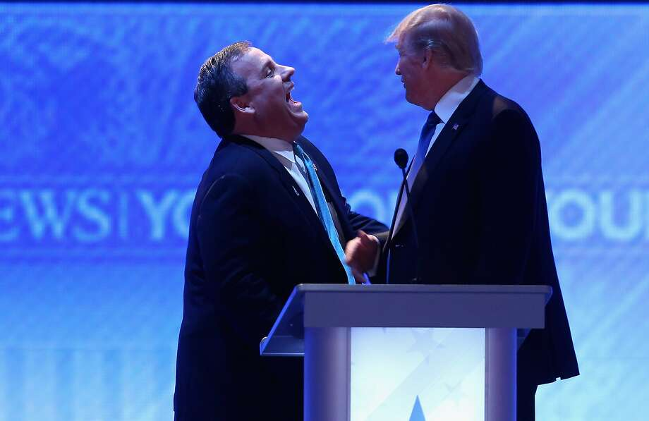 Republican presidential candidates New Jersey Gov. Chris Christie (left) and Donald Trump laugh during a commercial break in the New Hampshire debate. Photo: Joe Raedle, Getty Images