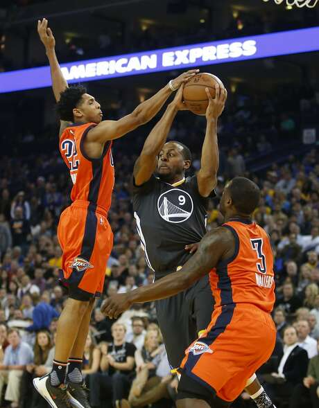 Golden State Warriors guard Andre Iguodala (9) passes the ball while defended by Oklahoma City Thunder guards Cameron Payne, left, and Dion Waiters during the second quarter of their basketball game on Saturday, February 6, 2016 in Oakland, Calif. Photo: Beck Diefenbach, Special To The Chronicle