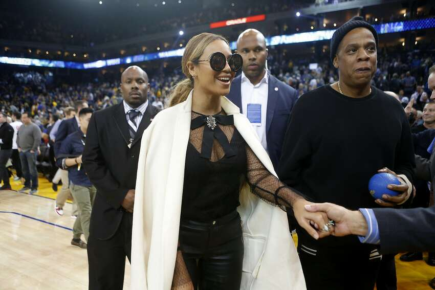 Beyoncé and Jay Z leave the court after the Golden State Warriors defeated the Oklahoma City Thunder on Saturday, February 6, 2016 in Oakland.