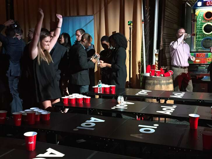Beer pong in a game room at the Big Game, Big Give party.