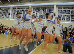 Ludlowe cheer compete during the FCIAC Cheerleading  Championship at the Wilton Field House in Wilton, Conn. on Feb. 6, 2016. Ludlowe was named Grand Champion.