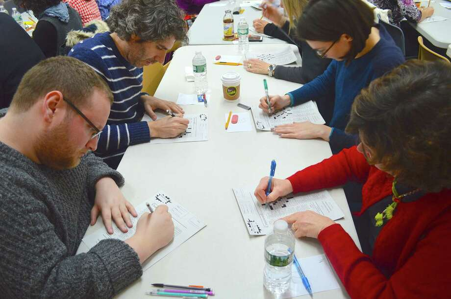 And the competiton begins at the annual Crossword Puzzle Contest at the Westport Library, with some of the comptitors who included Andy Kravis of Brooklyn, N.Y.; Jesse Lansner of New York City, Sara Nies of New York City and Jan O'Sullivan of Killingworth. Photo: Westport News / Jarret Liotta / Westport News