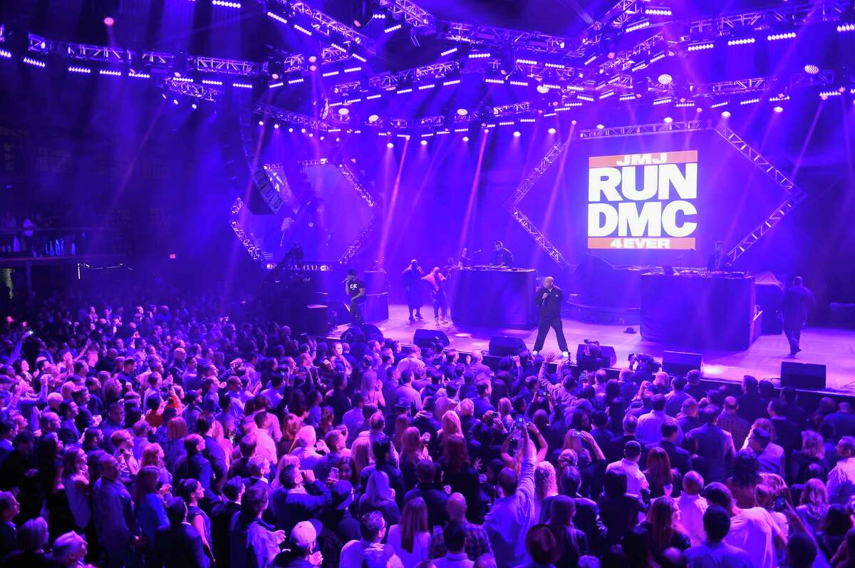 Recording artists Darryl 'D.M.C.' McDaniels (L) and Joseph 'Run' Simmons of Run-D.M.C. perform onstage during DirecTV Super Saturday Night co-hosted by Mark Cuban's AXS TV at Pier 70 on February 6, 2016 in San Francisco.