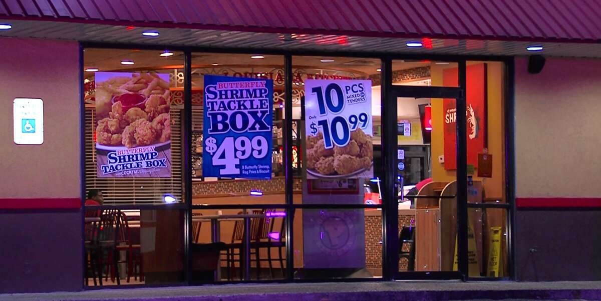 Police say a man walked through the back door of Popeyes fast food restaurant on the North Side, locked employees in the walk-in freezer at gunpoint and then fled with an undisclosed amount of money.