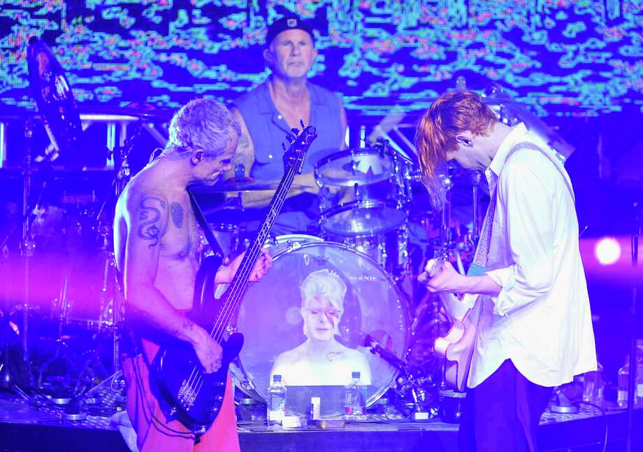 (L-R) Musicians Flea, Chad Smith and Josh Klinghoffer of The Red Hot Chili Peppers perform onstage during the DirecTV Super Saturday Night co-hosted by Mark Cuban's AXS TV at Pier 70 on February 6, 2016 in San Francisco. Photo: Steve Jennings, Getty Images For DIRECTV / 2016 Getty Images