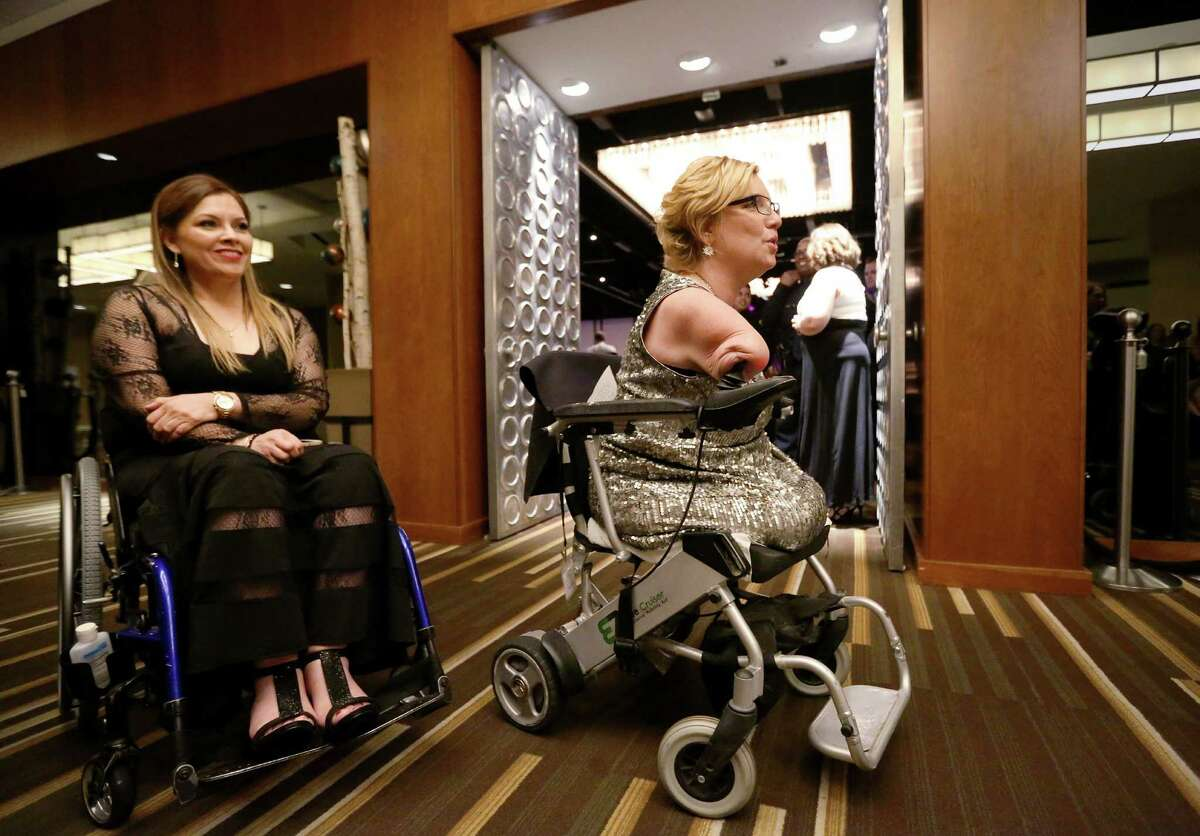 Katy Hayes, right, and Mayra Cantu get in line for their introductions at the 12th annual Ms. Wheelchair Texas Gala Saturday, Feb. 6, 2016, in Houston.