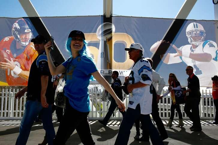Fans walks through Levi's Stadium before the Super Bowl on Sunday, Feb. 7, 2016 in Santa Clara, Calif.