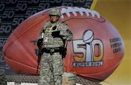 Military personnel stands guard out Levi's Stadium before the NFL Super Bowl 50 football game between the Denver Broncos and the Carolina Panthers,Sunday, Feb. 7, 2016, in Santa Clara, Calif.  (AP Photo/Matt Slocum)