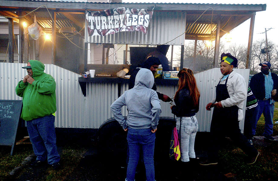 Small food stands alit the route for the Mardi Gras of Southeast Texas Majestic Krewe of Aurora's grand parade in Port Arthur Saturday.